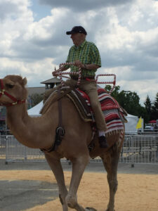 Bev Shaffer - Do Not Let What You Cannot Do - John Riding Camel at Ohio State Fair